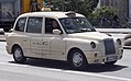 2010 LTI TX4 Gold, Berlin London cab front right.jpg