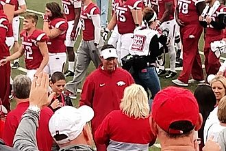 Dan Enos - Enos (center) celebrates with family after a win over Auburn