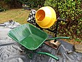 2018-07-30 Yellow cement mixer and green wheelbarrow, Trimingham.JPG
