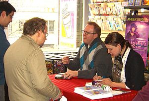 Amber Benson - Benson and novelist Anton Strout during an appearance at Midtown Comics Downtown in Manhattan, March 5, 2011