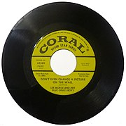45 rpm records, like this one from 1955, often held a single - one especially popular tune from a particular artist - with a flip side or b-side, a bonus for owners.