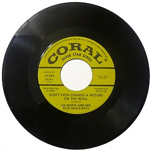 Single (music) - 45 rpm single record with large central hole as used in the USA for jukeboxes