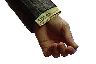 Corruption - Euro bank notes hidden in sleeve.