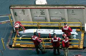 AGM-154 Joint Standoff Weapon - AGM-154 being brought to the flight deck of an aircraft carrier