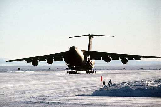A C-5B Galaxy aircraft lands on the ice runway near McMurdo Station during Operation Deep Freeze '90 DF-ST-90-10232
