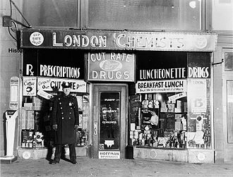 Mad Dog Coll - A New York City police officer standing outside the drugstore where Vincent Coll was murdered in 1932.