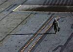 A Sailor walks across the flight deck of the aircraft carrier USS Nimitz (CVN 68). (30986418180).jpg