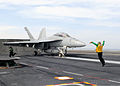 A U.S. Navy aircraft director signals an F-A-18F Super Hornet aircraft assigned to Strike Fighter Squadron (VFA) 2 on the flight deck of the aircraft carrier USS Ronald Reagan (CVN 76) May 3, 2013, while 130530-N-HT107-388.jpg