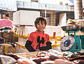 A child worker in retail, child labor in Hainan China December 2013.jpg