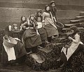 A group of fishing girls in the stairs down to the beach in Whitby, England, Sutcliffe, Frank Meadow (5226243302) (cropped).jpg
