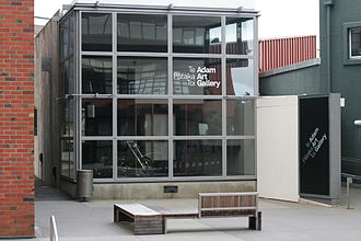 Adam Art Gallery - Frontage of the Adam Art Gallery. Its facade is made of glass. The Old Kirk building is located to the left of the gallery, and the Students' Union building to the right.