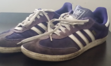A pair of Adidas shoes featuring the three stripes.