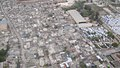 Aerial view of damaged Port Au Prince neighborhood and adjacent emergency shelter camps (4414442406).jpg