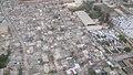 Aerial view of damaged Port Au Prince neighborhood and adjacent emergency shelter camps (4414442406).jpg