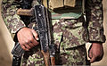 Afghan National Army Pvt. Zawail, a soldier with Headquarters and Service Company, 2nd Kandak, 1st Brigade, 215th Corps, holds an AK-47 rifle he found while searching a compound for narcotics and insurgent 120401-M-MM918-005.jpg