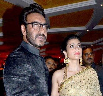 Ajay Devgn - Devgan with his wife Kajol at an event in 2013