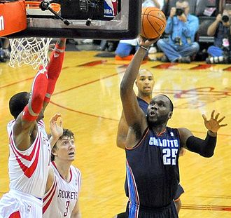 Al Jefferson - Jefferson takes a shot during his debut game for the Charlotte Bobcats on October 30, 2013.