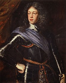 Formal portrait of Mary's father as a young man. He has long bushy hair, a fleshy face and wears a black suit of armour, with a brown shoulder sash.