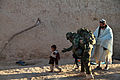 An Afghan National Army commando, center, greets a father and son while on patrol in Ghorak district, Kandahar province, Afghanistan, Jan. 17, 2012 120117-A-NC985-194.jpg