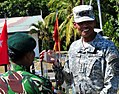 An Indonesian service member gives a gift to U.S. Army Gen. Vincent K. Brooks, right, the commanding general of U.S. Army Pacific, during Garuda Shield 14 in Surabaya, Indonesia, Sept 140924-A-NV708-663.jpg