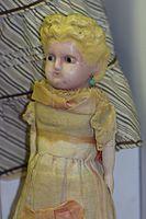 Antique German doll looking a bit startled (26096948275).jpg