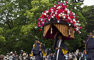 Aoi Matsuri - Man carrying a hollyhock float