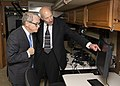 Arthur Huber shows Mike DeWine one of the monitors in the SkyVision recreational vehicle.jpg