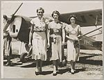 Australian Women Pilots' Association scholarship entrants, Jean Lotter, Tessa Williams and Paula Stafford (from left) in front of Auster J-4 Archer monoplane VH-AAL at an airfield, New South Wales, November 1952 (16103616669).jpg
