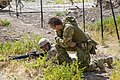 Australian soldier speaking with an Iraqi soldier during a training exercise in July 2018.jpg