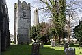 Belfry, round tower and churchyard at St. Columba's Church in Swords, Dublin-115223 (26563174995).jpg