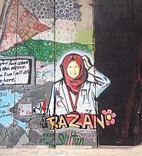 Bethlehem wall graffiti Razan with flower cropped.jpeg