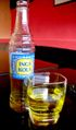 Bottle and glass of inca kola.jpg
