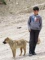 Boy with Sheepdog - Village of Laza - Caucasus Mountains - Azerbaijan (18030742118).jpg
