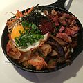Breakfast Bibimbap - Breakfast Congee - bacon, Portuguese sausage, heritage ham, kimchi, shiitakes, ong choy, sesame carrots, bean sprouts, sunny egg, crispy garlic rice (15675801963).jpg