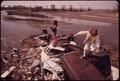 CHILDREN PLAY ON GARBAGE DUMP - NARA - 544794.tif