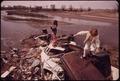 CHILDREN PLAY ON GARBAGE DUMP - NARA - 544794.tif