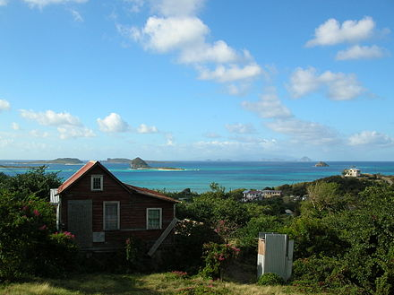 A view of Carriacou, with other Grenadine islands visible in the distance Carriacou Scene.jpg