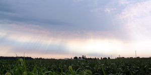 Carroll County, Indiana - Rainbow-fringed clouds above a farm and soybean fields in rural Jackson Township.