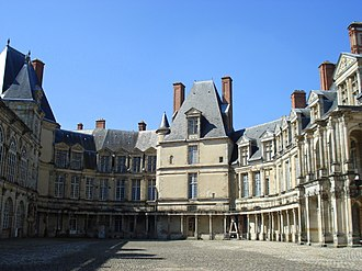 Palace of Fontainebleau - The Oval Courtyard, with the Medieval donjon, a vestige of the original castle where the King's apartments were located, in the center.