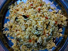 Chitranna (Lemon Rice) prepared by an indian woman.jpg