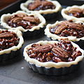 Chocolate Pecan Tarts on baking sheet in detail.jpg