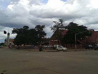 Kitwe - St Margaret's church of United Church in Zambia (right) and Catholic parish of Sacred Heart run by Conventual Franciscans (left), on the corner of Obote Avenue and Independence Avenue.