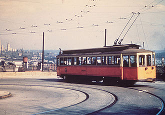 Streetcars in Cincinnati - A streetcar circa the 1940s, with the double trolley poles which were an almost-unique feature of the Cincinnati streetcar system