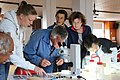 Citizen scientists around microscope.jpg