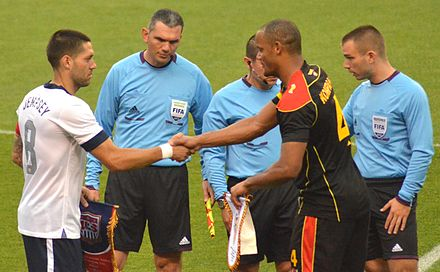 Belgian captain Kompany swaps pennants with United States' skipper Clint Dempsey in 2013 Clint Dempsey and Vincent Kompany exchange pennants USA vs Belgium.jpg