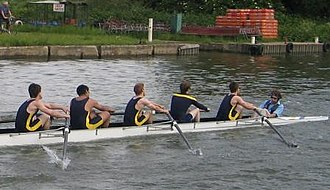 Coxswain (rowing) - Coxswain (right) with Stroke, 7th, 6th, 5th and 4th position rowers, at Summer Eights in Oxford