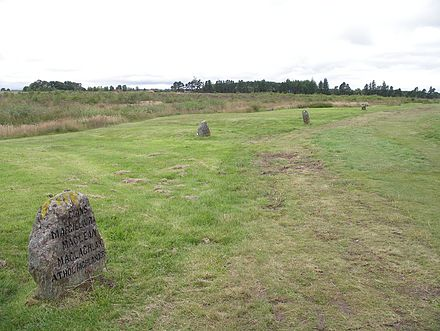 In 1881, Duncan Forbes erected the headstones that mark the mass graves of fallen Jacobite soldiers. They lie on either side of an early 19th-century road which runs through the battlefield. Culloden grave (road and three graves).jpg