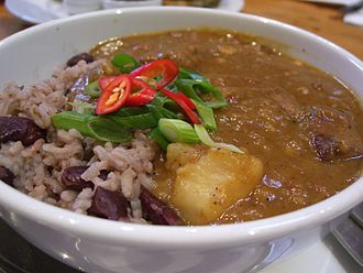 Jamaican cuisine - Curry goat with rice and peas