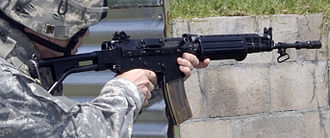 FN FNC - US Army infantryman fires an FNC assault rifle at a target during a stress shoot