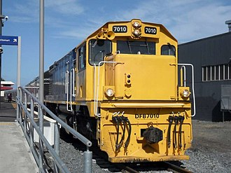 New Zealand DF class locomotive (1979) - DFB 7010 at Morningside station with a 6-car SA set
